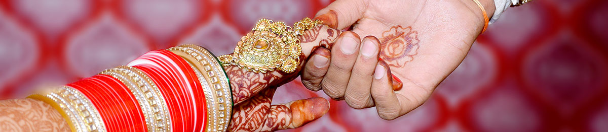 close-up of hands of indian bride and groom at their wedding